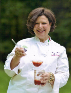 Teresa Coppola Morgan ladeling 825 MAIN Marinara Sauce into a jar